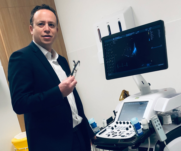 Dr Matthew Kahn, consultant cardiologist with echo, or echocardiogram, machine.